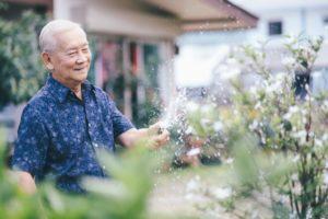 Happy senior man in his garden at home symbolizing better senior living at home